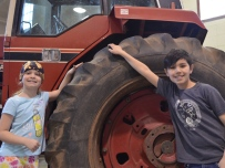 For Ella Code, 8 and Marcus Dahlin, 9, of C.D Howe Public School, it was a fun opportunity to get out of the classroom and learn. The students got to plant a tomato plant while they were there, something Ella enjoyed. She said she's not a fan of pizza, but 'I like growing stuff'. (Amy Hadley/CBC)