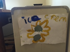 """On an old freezer in Ludwig's 'Ice Cream Parlour', she has a sign made for her by an 8-year old friend. """"She wanted to come and make ice cream with me,"""" she said. (Clare Bonnyman/CBC)"""