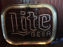 A Miller Lite beer sign is among the hot ticket items up for grabs, aside from the hippo and horse, of course. (Clare Bonnyman/CBC)