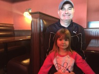 Rob Cain and his daughter Ellie, four, sought out the sale for some tables and chairs. (Clare Bonnyman/CBC)